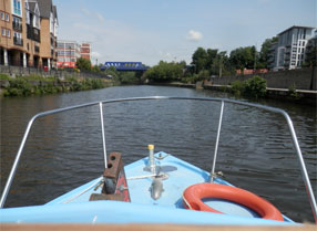 Hire Cruiser heading down stream on the River Medway from Maidstone