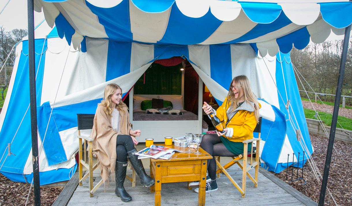 Friends outside glamping tent at Leeds Castle Knight's Glamping