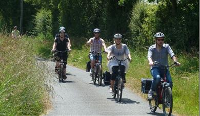A group of people on electric bikes