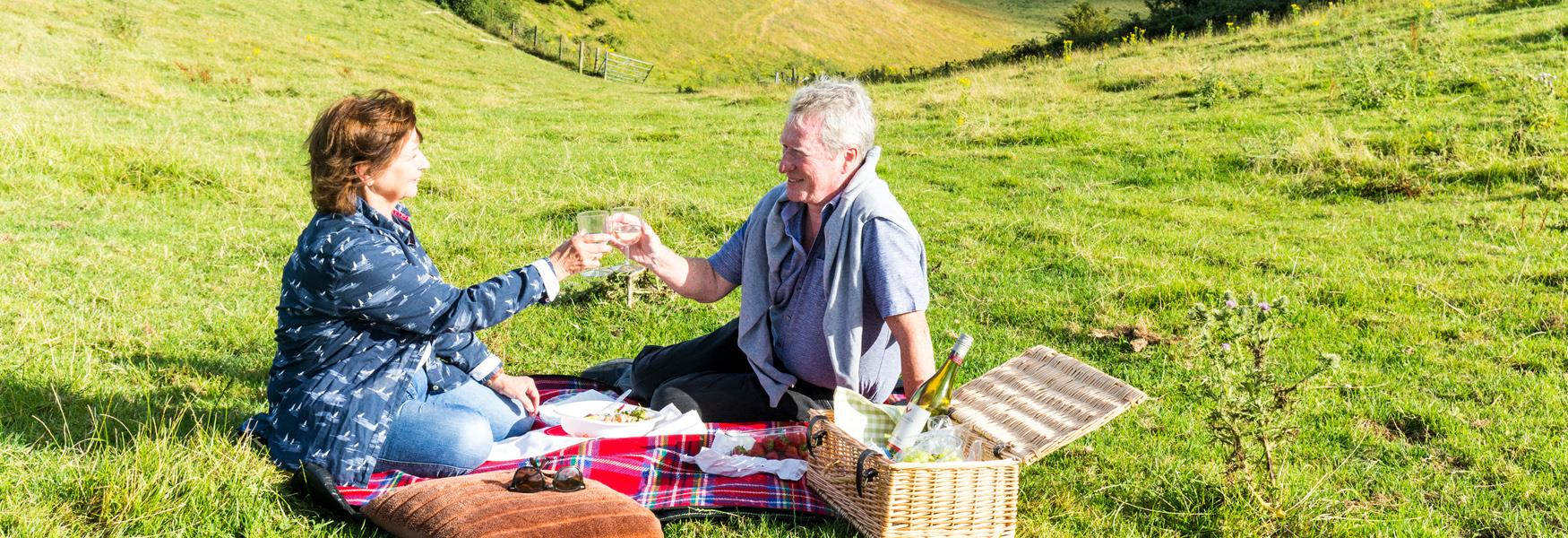 Couple having a picnic on the North Downs