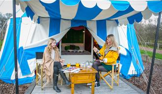 Friends outside glamping tent