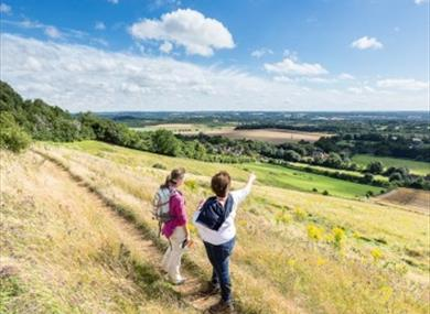 Walkers looking out over Thurnham from North Downs Way Trail